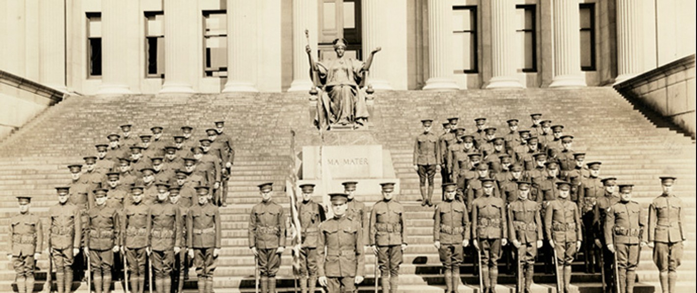 ROTC members at attention on the steps of Low Library